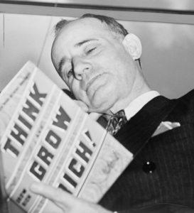 Napoleon Hill holding book 1937